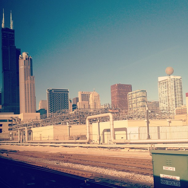 Exit strategy image of Chicago skyline as approached by Amtrak train (from south)